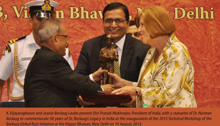 K. Vijayaraghavan and Jeanie Borlaug Laube present Shri Pranab Mukherjee